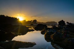 Rocky Beach Sunrise. Sunrise at Jungwok beach Gunungkidul Yogyakarta. A beach with full of rocks and corals Stock Images