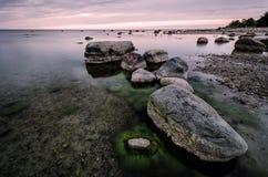 Rocky beach at sunrise light. Royalty Free Stock Photos