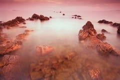 Rocky beach at sunset. Rocky beach at sunset in Chumphon Province, Thailand Stock Photo
