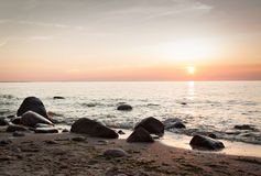 Rocky beach sunset Royalty Free Stock Photos
