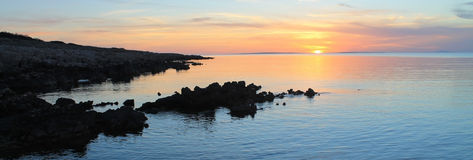 Rocky beach sunset, panoramic Royalty Free Stock Images