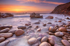 Rocky beach at sunset, Porth Nanven, Cornwall, England Royalty Free Stock Images