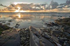 Rocky beach sunset reflection Stock Photography