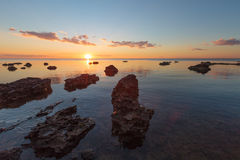 Rocky beach at sunset Stock Photography