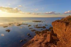 Rocky beach at sunset Royalty Free Stock Photos