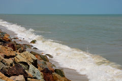 Rocky beach and surf in nature. Thailand Royalty Free Stock Photo