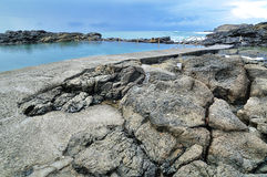 Rocky Beach with a Swimming Pool Stock Photos