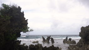 Rocky beach on a tropical island. Philippines,Siargao. Rocky beach with blue water on tropical island. Sea rocky coast, waves breaking to the rocky shore stock video