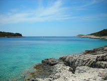 Rocky beach with turquoise waters, Hvar, Croatia Royalty Free Stock Images