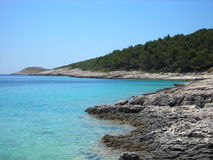 Rocky beach with turquoise waters, Hvar, Croatia Stock Images