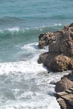 Rocky beach and waves Royalty Free Stock Photos