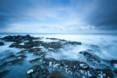 Rocky beach in winter royalty free stock photography