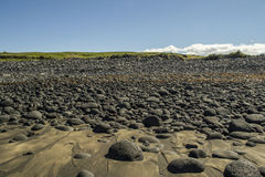 Rocky beach. Years of battering ocean waves the stones become perfectly smooth and rounded Royalty Free Stock Photos