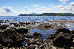 Rocky and Beautiful Antrim Coastline at Cushendall. Northern Ireland royalty free stock photo