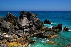 Rocky Bermuda coast. Line with blue ocean water Stock Photography