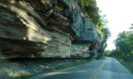 Rocky bluffs in south west Missouri. Rocky bluffs and cliffs line the curvy winding road in southwest Missouri near Noel and Lanagan. Beautiful rocks and trees Stock Photo