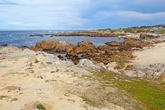 Rocky bluffs and tide pools at Asilomar State beach Royalty Free Stock Photo