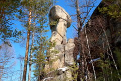 Rocky Butte `Idol` in the forest of the plateau in the upper reaches of the river Olkha Baikal region, Irkutsk region, Russian Fed. High boulder `Idol` of Stock Image