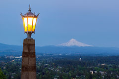 Rocky Butte Viewpoint with Mount Hood during Evening Blue Hour. Rocky Butte viewpoint in Portland Oregon with lamp post and Mount Hoods view during evening blue Royalty Free Stock Images