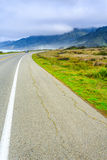 Rocky California coast road twists turns around rugged points of land as it continues north Royalty Free Stock Images