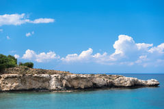 Rocky cape on a blue sea. Rocky cape on a beautiful blue sea Royalty Free Stock Images