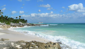 Rocky Caribbean beach in Mexico Stock Photos