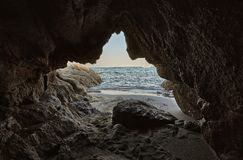 Get out of sadness and anguish. Rocky cave of a southern Sardinian beach overlooking the sea: a symbol of leaving your old being to cling to the new future stock photos