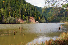 Rocky ceahlau peak and red lake. Which is a barrier dam lake near transylvania land of romania Royalty Free Stock Photos