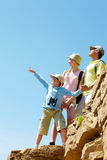On rocky cliff. Portrait of family members looking afar while standing on cliff Royalty Free Stock Photos