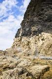 Rocky cliff Stock Photos