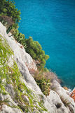 Rocky cliff and azure sea. Nice, France. Europe. Stock Image