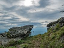 Rocky cliff with beautiful View from Khao Luang mountain in Ramkhamhaeng National Park. Sukhothai province Thailand royalty free stock photo