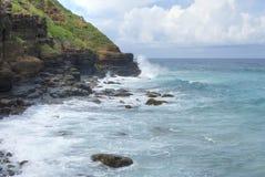 Rocky cliff Caribbean coastline Stock Photos
