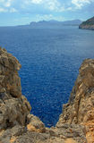 Rocky cliff at the edge of the Mediterranean Sea. On the island of Rhodes Stock Photo