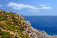 Rocky cliff at the edge of the Mediterranean Sea Royalty Free Stock Photos