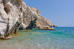 Rocky cliff at the edge of the Mediterranean Sea. On the island of Rhodes Royalty Free Stock Photography