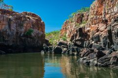 End point of Katherine Gorge river cruise in Northern Territory, Australia. Rocky cliff face with reflections on the Katherine River banks, the end point of the Royalty Free Stock Images