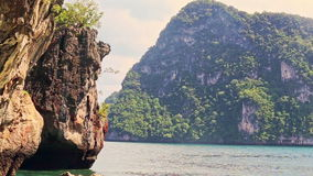 Rocky Cliff Green Cliffy Islands in Azure Tropical Sea stock video