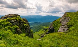 Rocky cliff on the hillside edge. Spectacular view of mountainous landscape Stock Photos