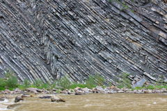 Rocky cliff of a mountain river Stock Image