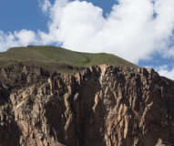 Rocky cliff in the mountains of Tajikistan. Landscape Stock Images