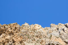 Rocky cliff over clean blue sky Stock Photo