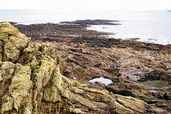 Rocky Cliff and over the Sea in Brittany France Stock Image