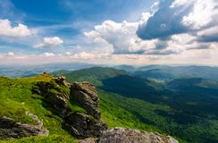 Rocky cliff over the valley. Beautiful mountain landscape in summer Royalty Free Stock Image