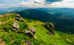 Rocky cliff over the valley. Beautiful mountain landscape in summer Royalty Free Stock Photos