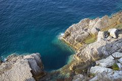 Rocky cliff overlooking the blue sea. Somewhere in Europe Royalty Free Stock Photography