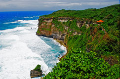 Rocky Cliffed Coast of Bali, Indonesia Stock Images