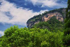 Rocky Cliffs of Wuyishan china. Rocky cliffs above the sanqingdian scenic area in Wuyishan in Fujian province China stock image