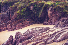 Rocky cliffs on beach Stock Photo