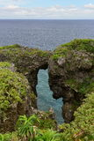 Rocky cliffs at Cape Manzamo in Okinawa Royalty Free Stock Images